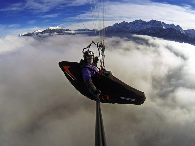 """Paragliding Thermik.net Cloudbusters by Daniel Kofler.  Awesome flight over the clouds towards the Dolomites of Lienz in Tirol/Austria. Shot with the GoPro HERO3 Black Edition"". (Photo by Daniel Kofler)"