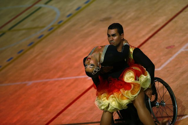 Steven Fenech and Roxanne Buttigieg of Malta dance as they compete during IPC Wheelchair Dance Sport European Championships in Lomianki near Warsaw, November 9, 2014. (Photo by Kacper Pempel/Reuters)