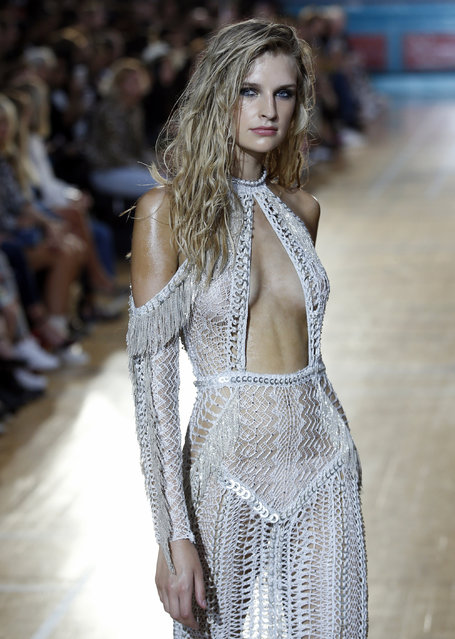 A model wears a creation by designer Julien Macdonald during his Spring/Summer 2017 runway show at London Fashion Week in London, Saturday, September 17, 2016. (Photo by Alastair Grant/AP Photo)