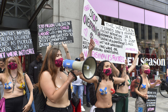 Naked activists holding placards during the Redress the Injustice Protest in London on September 9, 2020. Extinction Rebellion Fashion Action (XRFA) demonstrate outside the Topshop and Topman store on Oxford Street, opposing the fashion industry's many human, animal and environmental injustices claiming that, it currently produces around 10% of global carbon emissions. Its emissions are predicted to increase by around 50% by 2030. (Photo by Dave Rushen/SOPA Images/Sipa USA)