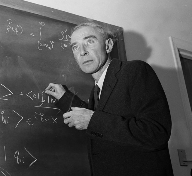 Dr. J. Robert Oppenheimer, creator of the atom bomb, is shown at his study in Princeton University's Institute for Advanced Study, Princeton, N.J., December 15, 1957. Oppenheimer has been leading an ivory tower career since the government banned him from classified science projects on security grounds. (Photo by John Rooney/AP Photo)