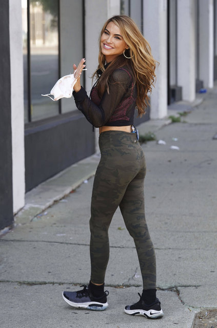 "American actress and real estate agent Chrishell Stause is seen arriving at the rehearsal studio for season 29 of ""Dancing With The Stars"" holding a face mask during the worldwide coronavirus pandemic on October 6, 2020 in Los Angeles, CA. (Photo by zz/GOTPAP/STAR MAX/IPx)"