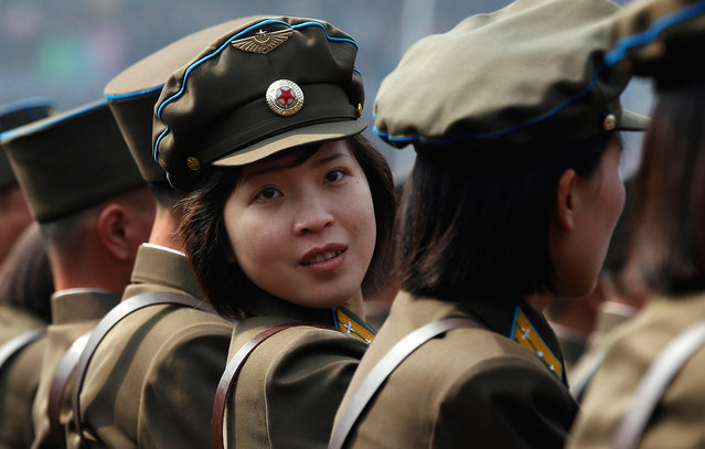 A soldier looks back during a ceremony in Pyongyang, on April 14, 2012, one day before the centenary of the birth of North Korea founder Kim Il-sung. (Photo by Bobby Yip/Reuters)