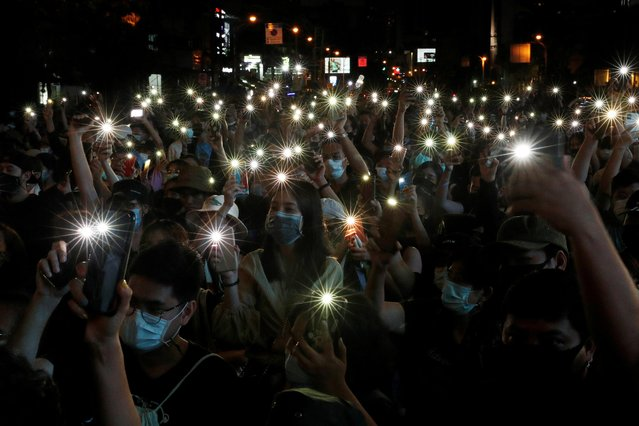 Pro-democracy protesters shine their mobile phone lights during an anti-government protest, in Bangkok, Thailand on October 18, 2020. (Photo by Jorge Silva/Reuters)