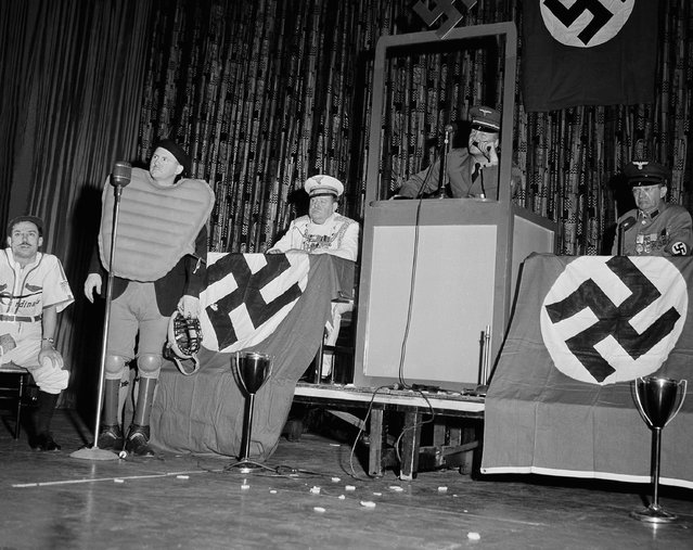 """The 21st Annual """"Eating and Oratorical Contest"""", staged by the New York chapter of the Baseball Writers' Association of America, was held in the Hotel Commodore in New York on February 6, 1944. From left to right: Chip Royal, of AP; Fred Weatherly, of the Mirror; Arthur Patterson, of the Herald-Tribune; and John Drebinger, of The Times, do a skit """"The Bumming of Berlin"""". (Photo by AP Photo)"""