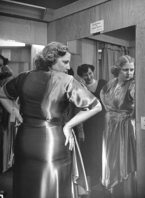 """""""Embarrassed at shop because she wears a size 40, Dorothy tries on new dress. A friend encouragingly points out that dieting has reduced waistline by two sizes"""". (Photo by Martha Holmes/Time & Life Pictures)"""