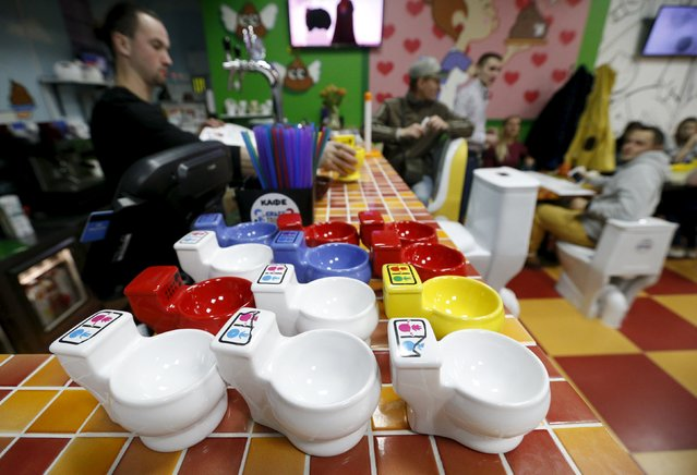 Cups designed in the likeness of urinals are seen on a counter at Crazy Toilet Cafe in central Moscow, Russia October 30, 2015. (Photo by Sergei Karpukhin/Reuters)