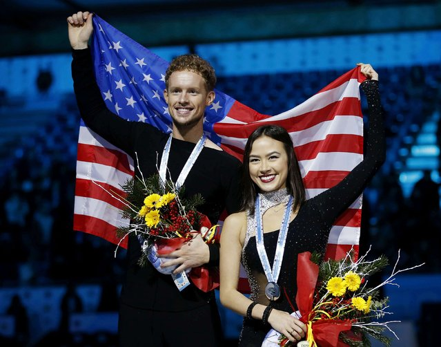 Madison Chock and Evan Bates of the U.S. pose with their silver medals and national flag on the podium after placing second in the Ice Dance final competition at the ISU Grand Prix of Figure Skating final in Barcelona December 13, 2014. (Photo by Gustau Nacarino/Reuters)
