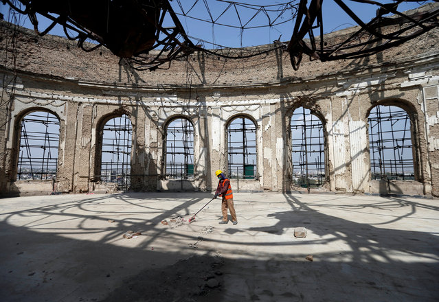 An Afghan worker sweeps inside of the ruined Darul Aman palace in Kabul, Afghanistan October 2, 2016. (Photo by Mohammad Ismail/Reuters)