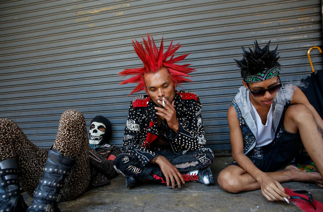 Myanmar punks wearing mohawk hairstyles take part in a punk gathering ahead of the Thingyan water festival in Yangon, Myanmar, 12 April 2018. Myanmar punks have been gathering in Yangon on the day ahead of Thingyan water festival to celebrate every year. The annual water festival is marked with large groups of people congregating to celebrate by splashing water and throwing powder at each others faces as a symbolic sign of cleansing and washing away the sins from the old year to mark the traditional New Year in countries such as Myanmar, Thailand, Laos and Cambodia. This year, the Myanmar Thingyan water festival falls on 13 April and ends on 16 April. (Photo by Lynn Bo Bo/EPA/EFE)