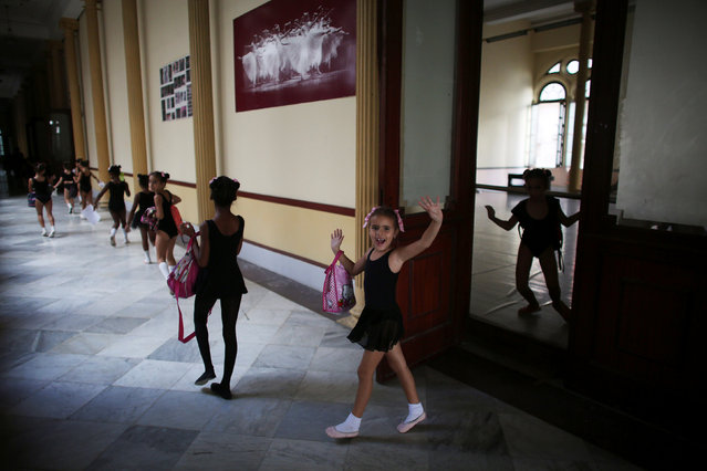 A child reacts to the camera at the Cuba's National Ballet School (ENB) in Havana, Cuba, October 12, 2016. (Photo by Alexandre Meneghini/Reuters)
