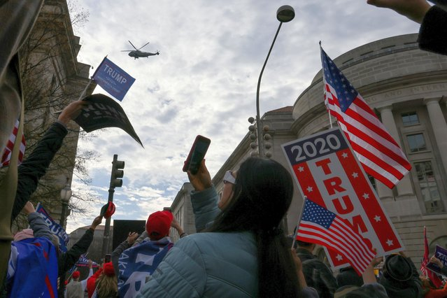 Marine One, carrying U.S. President Donald Trump, passes over people attending a rally to protest the results of the election in front of Supreme Court building, in Washington, U.S., December 12, 2020. (Photo by Jonathan Ernst/Reuters)