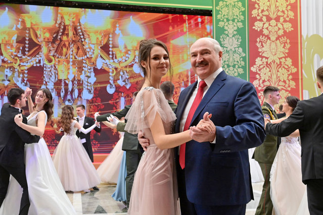 Belarus' President Alexander Lukashenko (R) dances with a woman during the New Year's Youth Ball in the Palace of Independence in Minsk, Belarus on December 29, 2020. A total of 314 young people from various Belarusian regions have been invited to the event, namely comprehensive and vocational school pupils, university and college students. (Photo by Maxim Guchek/TASS via Getty Images)