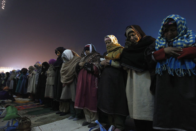 Kashmiri Muslim women offer prayers during the festival of Eid-e-Milad at Hazratbal shrine on a cold winter morning in Srinagar January 4, 2015. (Photo by Danish Ismail/Reuters)
