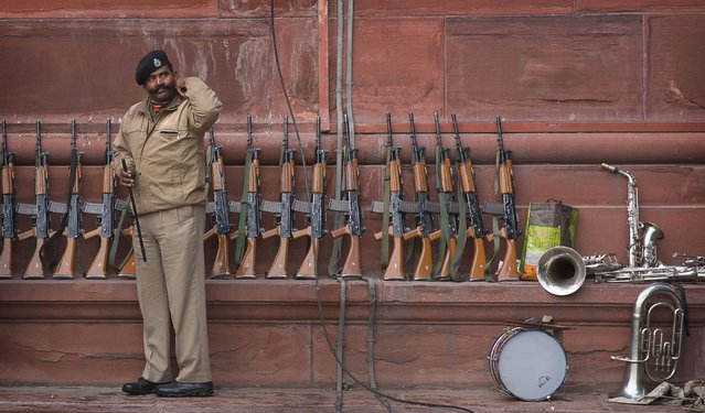 An Indian Border Security Force soldier from camel mount division adjusts his collar at a practice for the upcoming Republic day parade in New Delhi, India, Wednesday, January 7, 2015. (Photo by Manish Swarup/AP Photo)