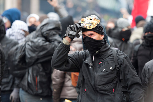 A demonstrator with an anonymous mask is seen during the forbidden COP21 demonstration on November 29, 2015 in Paris, France. (Photo by Aurelien Meunier/Getty Images)