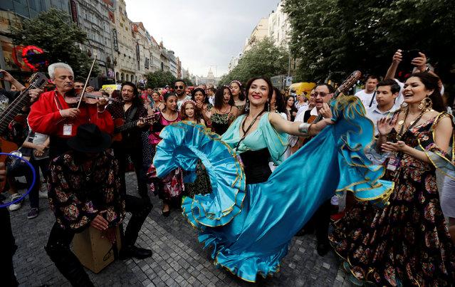 Participants of the Khamoro World Roma Festival dance through the historical centre of Prague, Czech Republic, on June 1, 2018. (Photo by David W. Cerny/Reuters)
