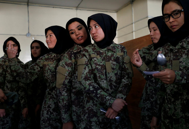 Female soldiers from the Afghan National Army (ANA) wait to get food at the Kabul Military Training Centre (KMTC) in Kabul, Afghanistan October 23, 2016. (Photo by Mohammad Ismail/Reuters)