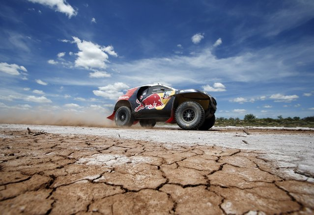 Peugeot driver Carlos Sainz of Spain drives during the 2nd stage of the Dakar Rally 2015, from Villa Carlos Paz to San Juan January 5, 2015. (Photo by Jean-Paul Pelissier/Reuters)