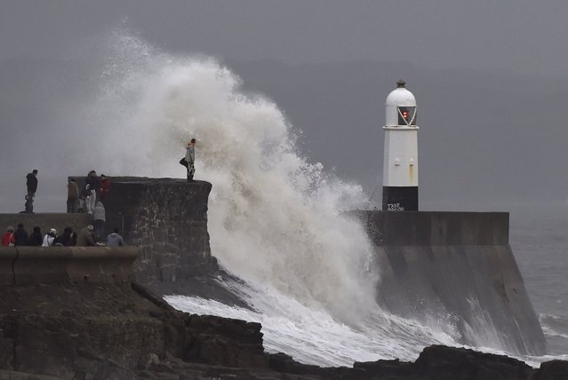 A man and a child stand on the harbour wall during stormy conditions at Porthcawl, South Wales, December 6, 2015. (Photo by Rebecca Naden/Reuters)