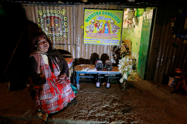 A witch doctor sits with skulls before the celebrations of The Day of Skulls in El Alto, on the outskirts of La Paz, Bolivia, November 7, 2016. (Photo by David Mercado/Reuters)