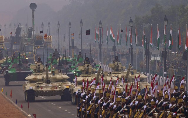 T-90 tanks roll down Rajpath, a ceremonial boulevard that runs from Indian President's palace to war memorial India Gate, as part of the full dress rehearsal ahead of Republic Day parade in New Delhi, India, Friday, January 23, 2015. (Photo by Saurabh Das/AP Photo)