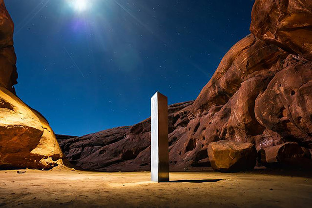 A monolith placed in the Utah wilderness in November 2020. New clues have surfaced in the disappearance of the gleaming monolith that seemed to melt away as mysteriously as it appeared in the red-rock desert. A Colorado photographer told a TV station in Salt Lake City that he saw four men push over the hollow, stainless steel structure last Friday night. (Photo by Terrance Siemon/AP Photo)