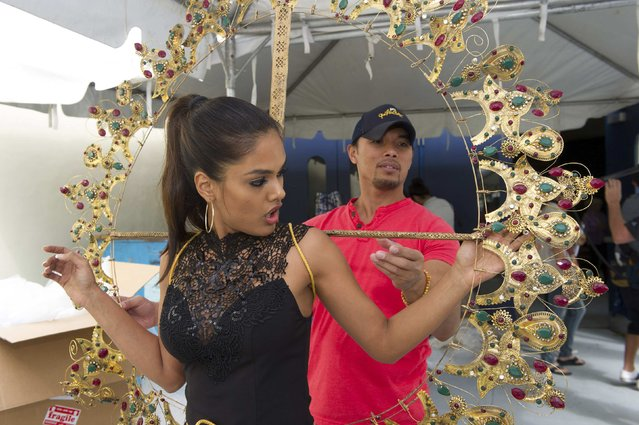 Noyonita Lodh, Miss India 2014, tries on her costume during rehearsals during the 63rd annual Miss Universe Pageant in Miami, Florida in this January 20, 2015 handout photo. (Photo by Reuters/Miss Universe Organization)