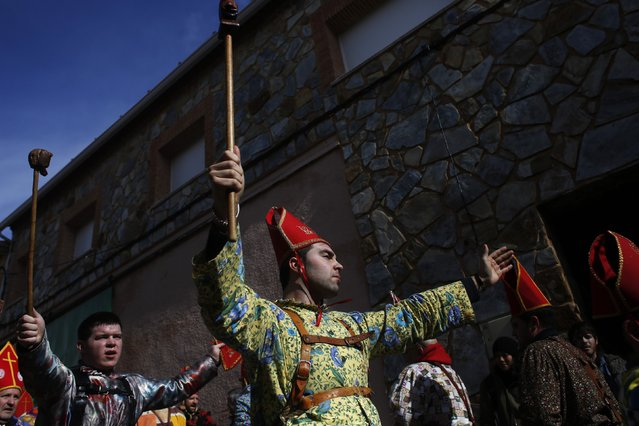 """Believers dressed as """"diablos"""" (devils), dance as they parade around town during the """"Endiablada"""" festival in Almonacid del Marquesado, in central Spain February 3, 2015. (Photo by Susana Vera/Reuters)"""