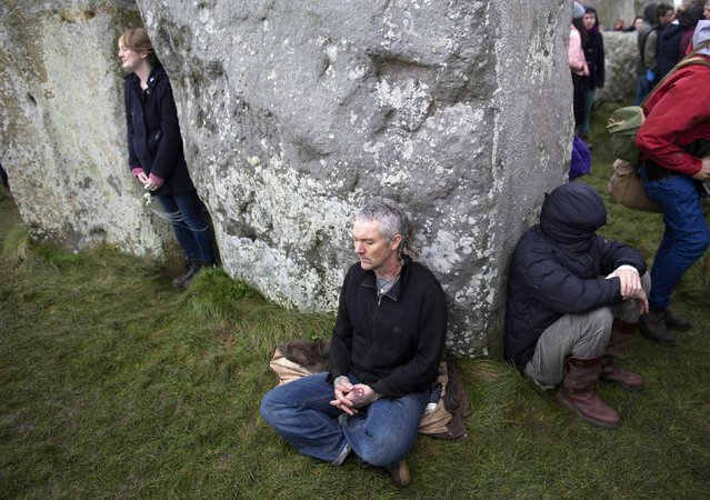 Revellers meditate as they celebrate the winter solstice at Stonehenge on Salisbury Plain in southern England December 22, 2015. (Photo by Kieran Doherty/Reuters)