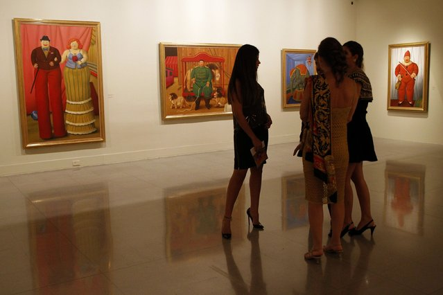 """People attend the opening of Colombian painter and sculptor Fernando Botero's exhibition """"The Circus"""" at the Museum of Antioquia in Medellin, Colombia February 2, 2015. The exhibition will open to the public from February 3 to May 17. (Photo by Fredy Builes/Reuters)"""