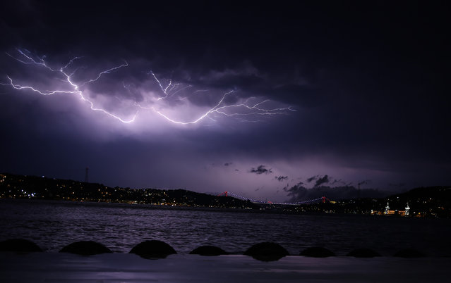 Lightnings illuminate the sky at night during a heavy rainfall on June 28, 2018 in Istanbul, Turkey. (Photo by Emrah Yorulmaz/Anadolu Agency/Getty Images)