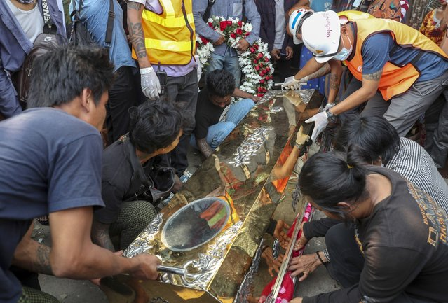 The body of Saw Pyae Naing is placed in a coffin in Mandalay, Myanmar, Sunday, March 14, 2021. (Photo by AP Photo/Stringer)