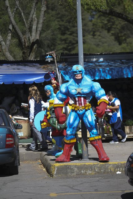 Effigies made in the likeness of comic book super heroes are seen at a stall in preparation for New Year's eve in Quito December 30, 2015. As a part of tradition, Ecuadoreans burn effigies on the street at midnight in New Year's eve. (Photo by Guillermo Granja/Reuters)
