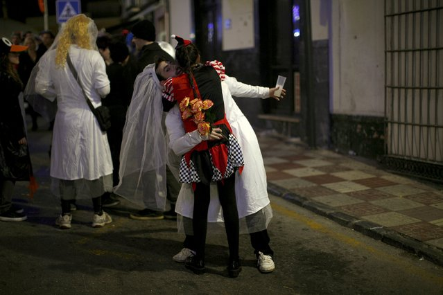 A couple embrace as they take part in New Year celebrations in Coin, near Malaga, southern Spain, January 1, 2016. (Photo by Jon Nazca/Reuters)