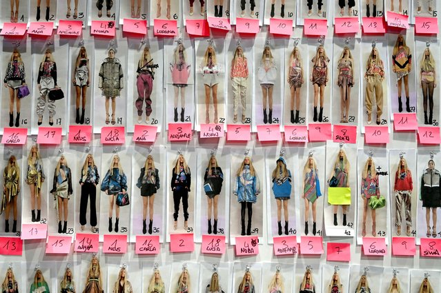 Pictures of models are displayed on a board on backstage prior to the presentation of Spanish designer Andres Sarda's Autumn – Winter 2021 / 2022 collection during the Mercedes Benz Fashion Week in Madrid on April 8, 2021. (Photo by Gabriel Bouys/AFP Photo)