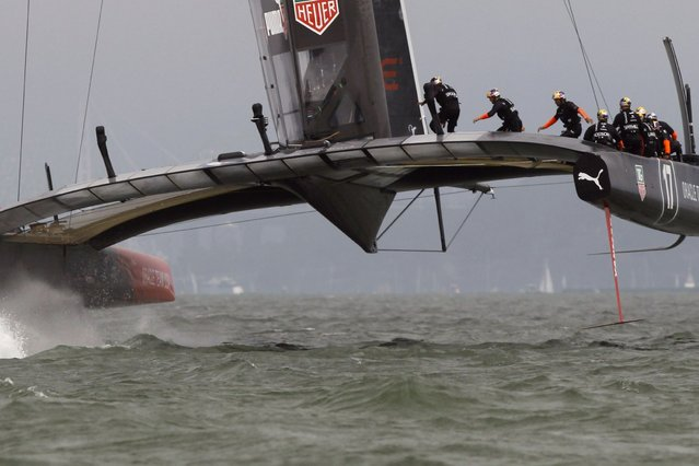 Oracle Team USA rounding the first mark against Emirates Team New Zealand during Race 4 of the 34th America's Cup yacht sailing race in San Francisco, on September 11, 2013. (Photo by Reuters)