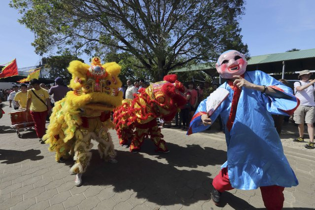 Surinamese citizens of Chinese origin participate in Chinese New Year celebrations at a joint banquet and temple fair in Paramaribo, Suriname February 19, 2015. (Photo by Ranu Abhelakh/Reuters)