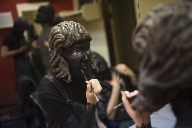 "An actor from the Israeli theatre group Orto-Da puts on makeup in a dressing room before their show titled ""Stones"", at a theatre in Tel Aviv March 10, 2015. (Photo by Amir Cohen/Reuters)"