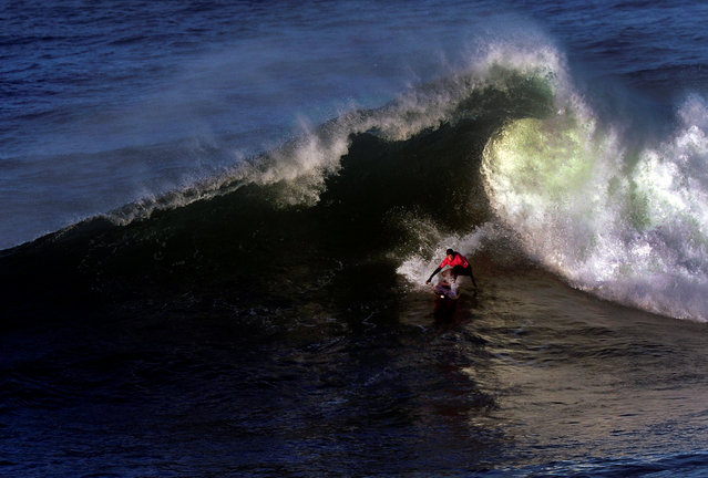 French surfer Justine Dupont rides a large wave at El Bocal during the Vaca Gigante (Big Cow) giant wave surf competition in Santander, northern Spain December 17, 2016. (Photo by Vincent West/Reuters)