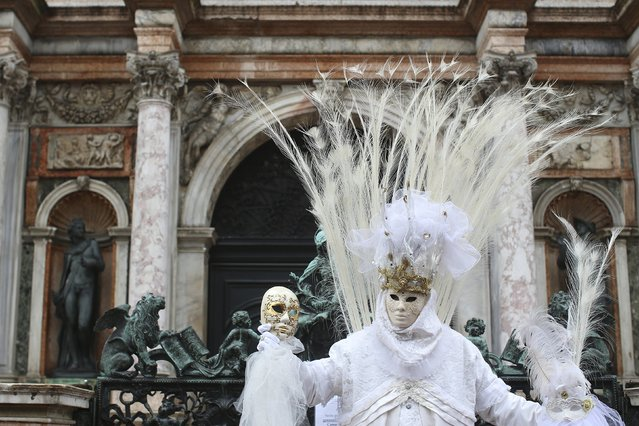 A masked reveller poses at San Marco Piazza during the Venice Carnival, January 31, 2016. (Photo by Alessandro Bianchi/Reuters)