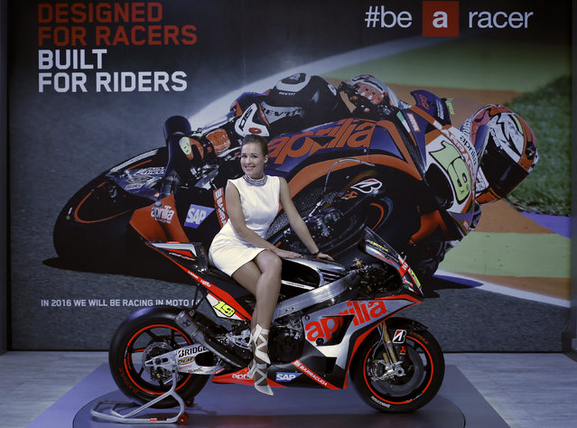 A model poses on Aprilia motorcycle displayed at the Indian Auto Expo in Greater Noida, on the outskirts of New Delhi, India, February 4, 2016. (Photo by Anindito Mukherjee/Reuters)
