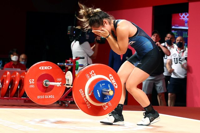USA's Jourdan Elizabeth Delacruz reacts as she competes in the women's 49kg weightlifting competition during the Tokyo 2020 Olympic Games at the Tokyo International Forum in Tokyo on July 24, 2021. (Photo by Edgard Garrido/Reuters)
