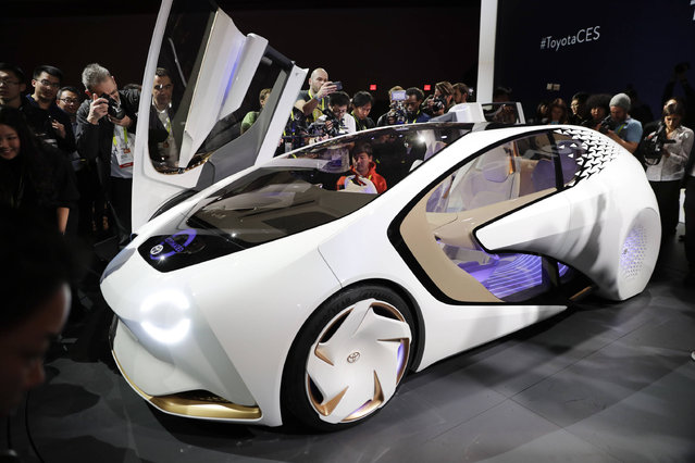 People take pictures of the Toyota Concept-i during a news conference at CES International Wednesday, January 4, 2017, in Las Vegas. (Photo by Jae C. Hong/AP Photo)