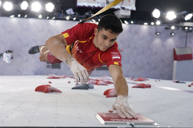 Alberto Gines Lopez, of Spain, competes during the speed portion of the men's sport climbing final at the 2020 Summer Olympics, Thursday, August 5, 2021, in Tokyo, Japan. (Photo by Tsuyoshi Ueda/Pool Photo via AP Photo)