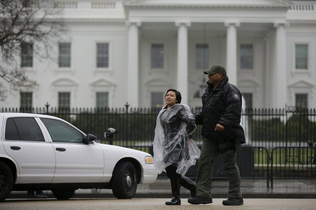 An anti-deportation demonstrator is detained by the police during a protest outside the White House in Washington, February 23, 2016. (Photo by Carlos Barria/Reuters)