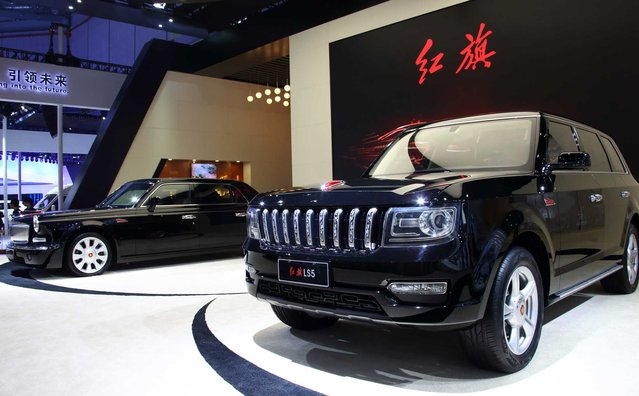 China FAW Group Corp.'s Hongqi brand H7, left, and LS5 vehicles are displayed at the 16th Shanghai International Automobile Industry Exhibition (Auto Shanghai 2015) in Shanghai, China, on Monday, April 20, 2015. (Photo by Tomohiro Ohsumi/Bloomberg)