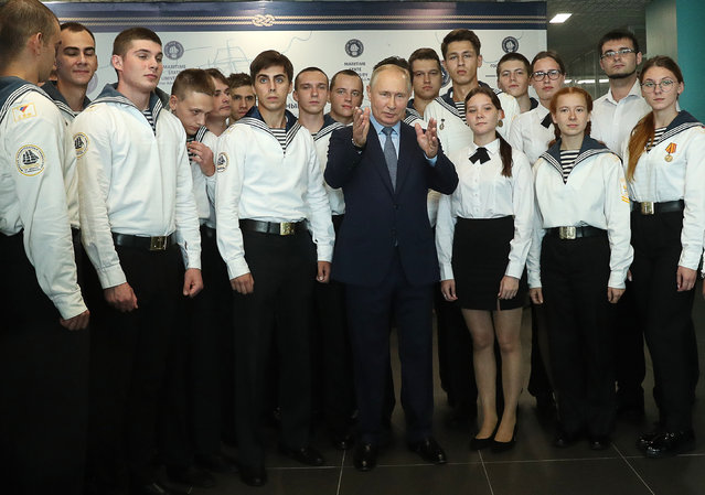 Russia's President Vladimir Putin (C) poses for a photo with students at the Far East Maritime Training Centre of the Admiral Nevelskoy Maritime State University in Vladivostok, Russia on September 2, 2021. (Photo by Mikhail Tereshchenko/TASS)