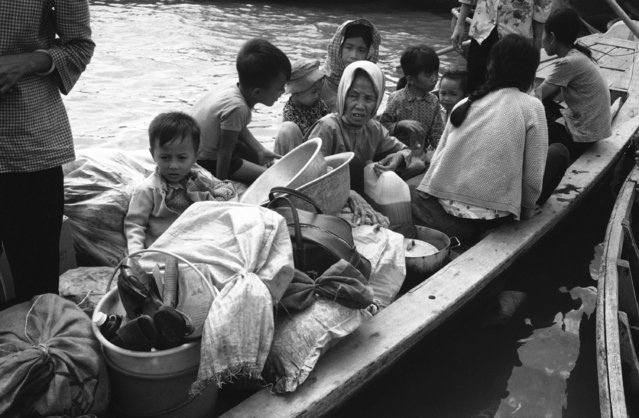 While many South Vietnamese are scrambling to board airliners out of their troubled country, these homeless peasants are glad to arrive by boat at government controlled Vung Tau, a coastal town near Saigon on April 24, 1975. These refugees fled Binh Tuy province, the 20th to change hands during the current North Vietnamese Viet Con offensive. (Photo by AP Photo/Kim)