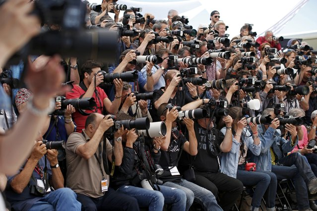 "Photographers work during a photocall for the film ""Irrational Man"" out of competition at the 68th Cannes Film Festival in Cannes, southern France, May 15, 2015. (Photo by Benoit Tessier/Reuters)"